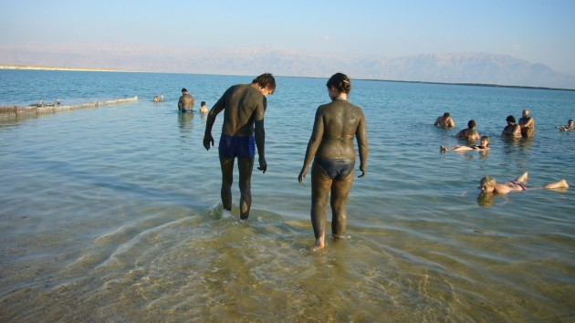 People covered in mud - Dead Sea
